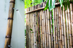 Tropical outdoor shower surrounded with bamboo walls Royalty Free Stock Photos