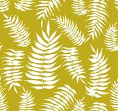 Tropical palm leaves seamless pattern on the yellow background. Tropical palm leaves seamless patter on the yellow background. White palm leaves. Tropical Stock Images