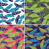 Tropical Palm leaves seamless vector patterns Royalty Free Stock Images