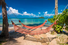 Tropical Palm Trees and Hammock at Trat in Thailand Summer Stock Photography