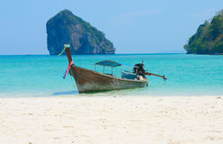 Tropical paradise. Thai fishing boat on the sand royalty free stock images