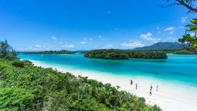 Tropical paradise beach with clear blue lagoon water, Ishigaki Island, Okinawa, Japan. White sand tropical beach and crystal clear blue lagoon water, Kabira Bay Royalty Free Stock Photos