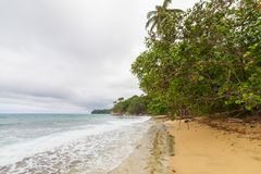Tropical paradise beach Costa Rica. Tropical paradise beach in Costa Rica at cloudy day Royalty Free Stock Image