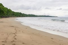 Tropical paradise beach Costa Rica. Tropical paradise beach in Costa Rica at cloudy day Royalty Free Stock Images