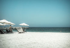 Tropical Paradise. Beach with sun loungers and parasols in Dubai, on the Persian Gulf. The Emirate of RAS al Khaimah. Tinted Stock Photo