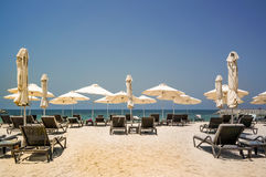 Tropical Paradise. Beach with sun loungers and parasols in Dubai, on the Persian Gulf. The Emirate of RAS al Khaimah. Tinted Stock Photography