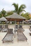 Tropical paradise huts Stock Photos
