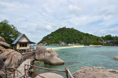 Tropical paradise - lagon and white sand beach at a small island. With stunning green hills at the background Stock Image