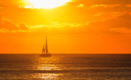 Tropical paradise, perfect sunset, ship go home Royalty Free Stock Images
