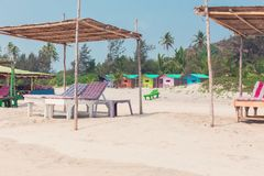 Tropical paradise is a sandy beach with colorful bungalows. Stock Photography
