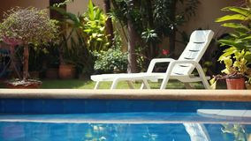 Tropical paradise. Sunbed lounger near the swimming pool. 1920x1080 stock video