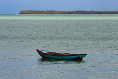Tropical paradise typical scenery: colored wooden boats docked in the sea. Miches Bay or Sabana De La Mar lagoon, northern royalty free stock photography