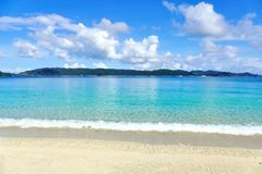 Tropical paradise of white sand, turquoise sea and deep blue sunny sky at Zamami, Okinawa, Japan royalty free stock photo