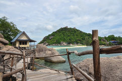 Tropical paradise - wooden pathway along the seaside and a small. House at an island Stock Image
