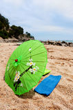 Tropical parasol at the beach Stock Image
