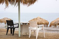 Parasols at Maleme beach on Crete. Tropical parasols at Maleme beach on Crete, Greece Royalty Free Stock Photography