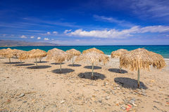 Tropical parasols at Maleme beach on Crete Stock Photo