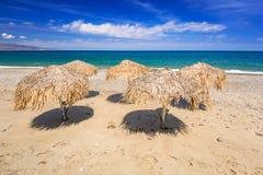 Tropical parasols at Maleme beach on Crete Stock Photos