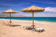 Tropical parasols at Maleme beach on Crete Stock Photography
