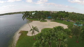 Tropical park from above. Aerial view of tropical lakefront park in Florida uSA stock video footage