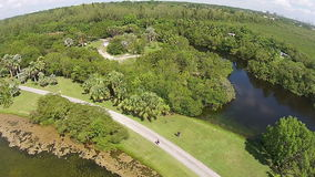 Tropical park aerial view. Aerial view of lake and park in Florida stock footage