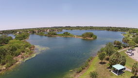 Tropical park in Florida aerial view. Tropical park and lake in Florida 360 degree aerial view stock footage