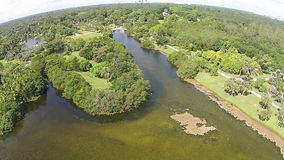 Tropical park in Florida aerial view. Tropical lake and park in South Florida flyover view stock video footage