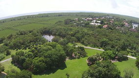 Tropical park in Florida aerial view. Tropical park and scenery in Florida flyover aerial view stock footage