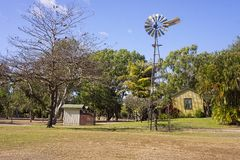 Tropical park with windmill. Park in Ayr, Queensland, Australia with old time hut and windmill royalty free stock image