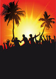 Tropical party silhouettes. Silhouettes of a crowd dancing in a glowing sunset with palm trees Stock Image