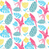 Tropical pattern with hand drawn leaves, exotic flowers and parrots. Hawaiian seamless texture, bright fabric design Royalty Free Stock Images