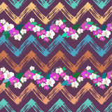 Tropical pattern with orchids and zigzag lines Stock Images