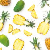 Tropical pattern of pineapple and mango fruits on white background. Flat lay, top view. Food concept. Royalty Free Stock Image