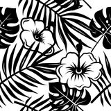Tropical pattern 004. Seamless pattern with leaves of tropical plants and exotic flowers. Floral decorative background, floral wallpaper, vectors Stock Photography