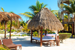 Tropical pavillion on the beach of Carribean sea Royalty Free Stock Images