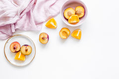 Tropical peach and orange fruits for fresh juice with towel white background top view space for text Royalty Free Stock Photos