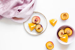 Tropical peach and orange fruits for fresh juice with towel white background top view space for text Royalty Free Stock Photography