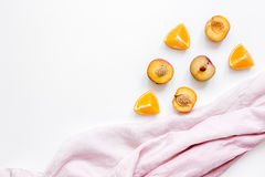 Tropical peach and orange fruits for fresh juice with towel white background top view space for text Stock Images