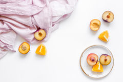 Tropical peach and orange fruits for fresh juice with towel white background top view space for text Royalty Free Stock Image
