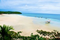 Tropical Philippines beach. A view of a wide, sandy tropical beach on the Camotes Islands, Philippines Stock Photos