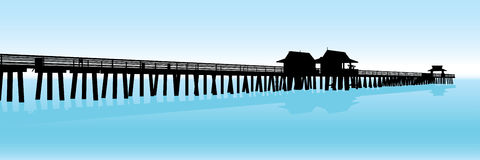 Tropical Pier. Silhouette of a tropical pier on the Gulf of Mexico in Naples, Florida, USA Stock Image