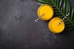 Tropical pineapple alcogolic cocktail on a black background royalty free stock images
