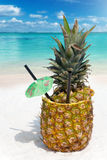 Tropical Pineapple drink in the sand Royalty Free Stock Image