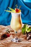 Tropical pineapple milkshake sand leaves Cherry Stock Photos