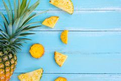 Tropical pineapple slices on wood plank blue color. stock photos