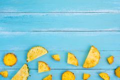 Tropical pineapple slices on wood plank blue color. Stock Images