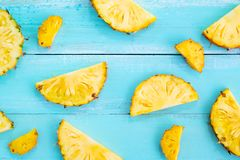 Tropical pineapple slices on wood plank blue color. Royalty Free Stock Image