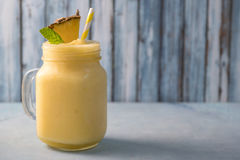 Tropical pineapple smoothie. Tropical pineapple slush smoothie in mason jar Royalty Free Stock Photos