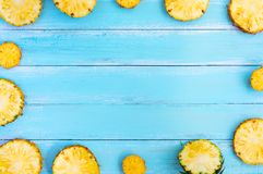 Tropical pineapple on wood plank blue color. Frame layout summer vacation background concept stock photos
