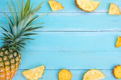 Tropical pineapple on wood plank blue color. Royalty Free Stock Photo